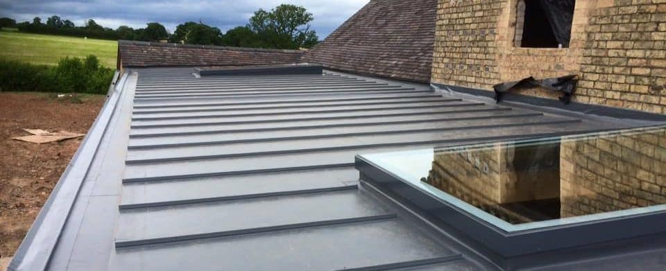 New Flat Roof Extension with decorative standing seam profile.